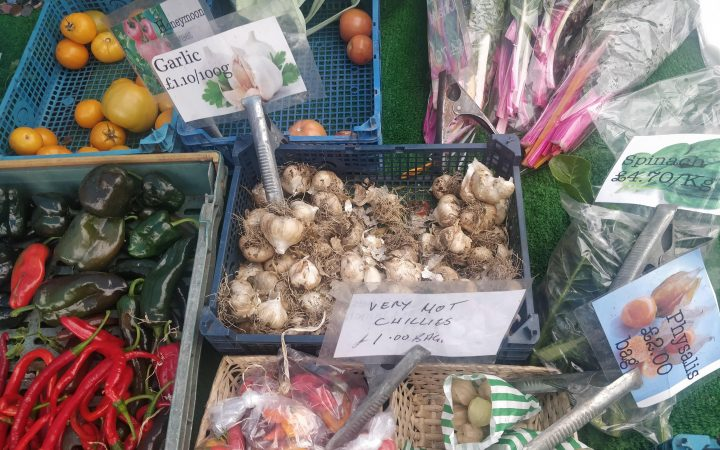 Fresh vegetables at a farmers market. Slightly muddy.