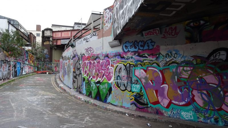 Graffiti covered wall upon exit of Leake Street Tunnel