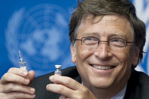 Bill Gates holding vaccine