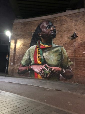 Street art on Pope's Road of well known Brixton figure Michael Johns.