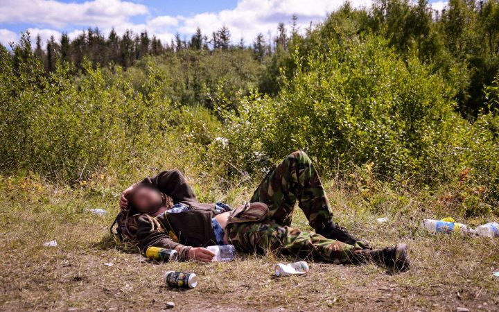 Man lying on grass, free party