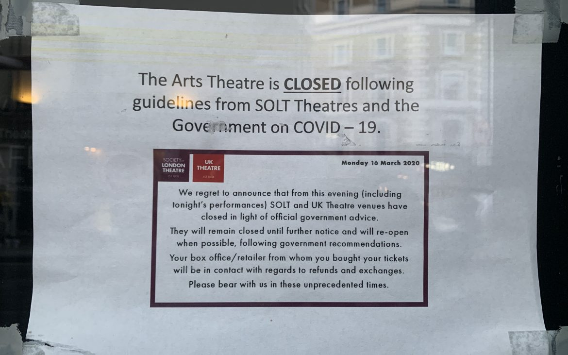 A COVID notice on window of The Arts Theatre old home of musical Six