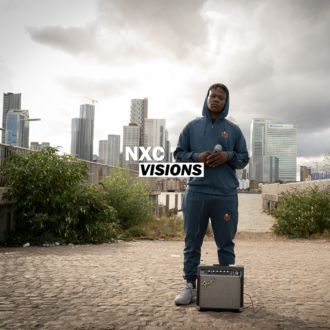 Young man stands with London skyline behind
