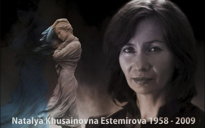 A black and white memorial photo of Natalya Estemirova, with her full name at the bottom and a headshot of her with a statue in the background.