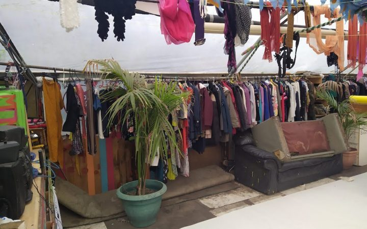 Clothes on hangers in a hut