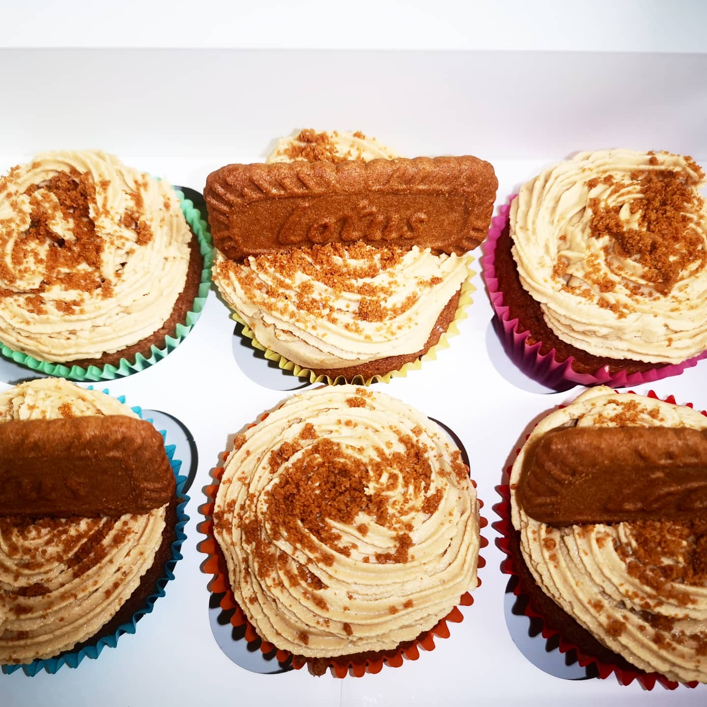 Lotus biscuit cupcakes in sit in a white takeaway box