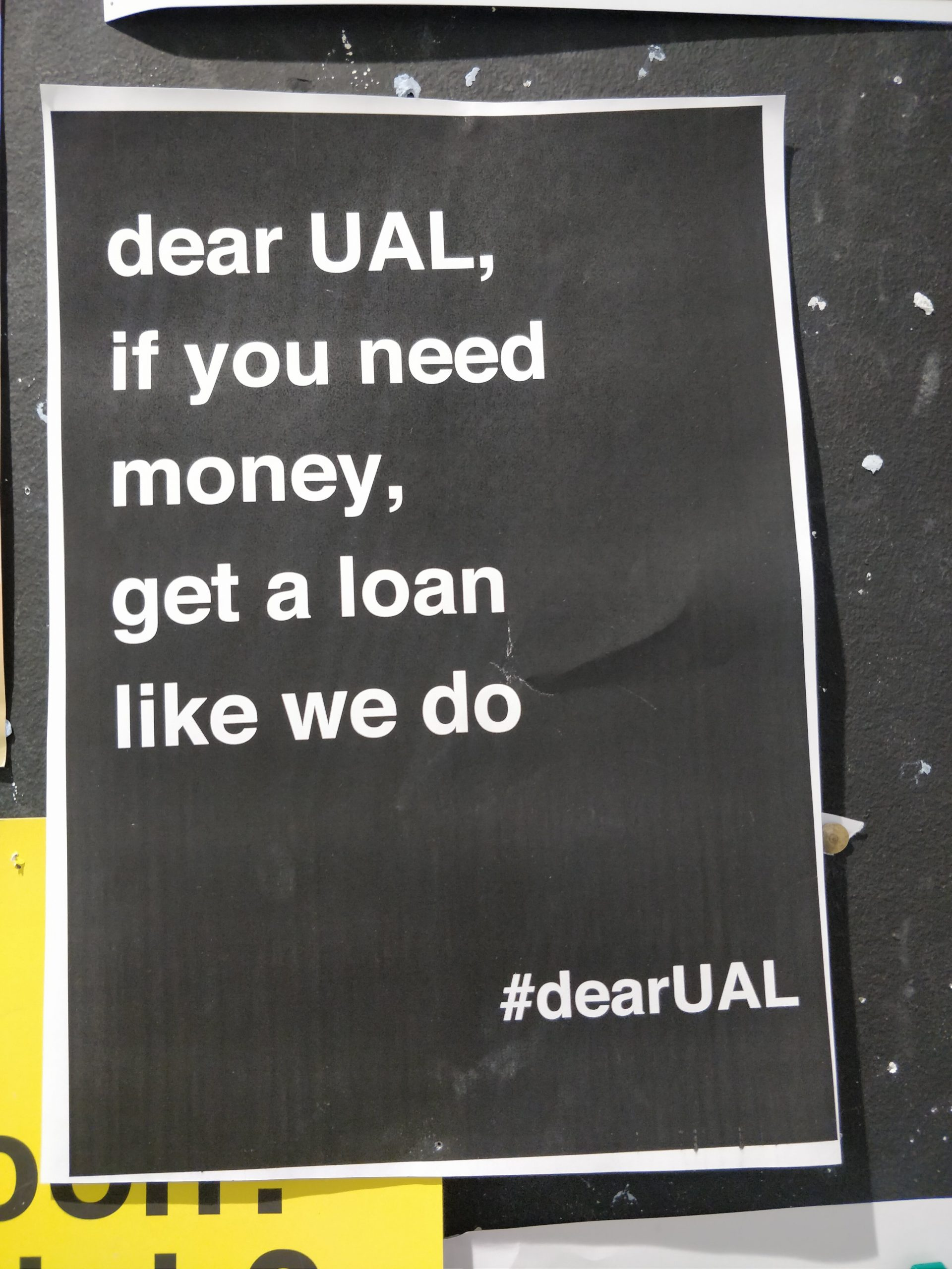 Poster that reads: dear UAl, if you need money, get a loan like we do