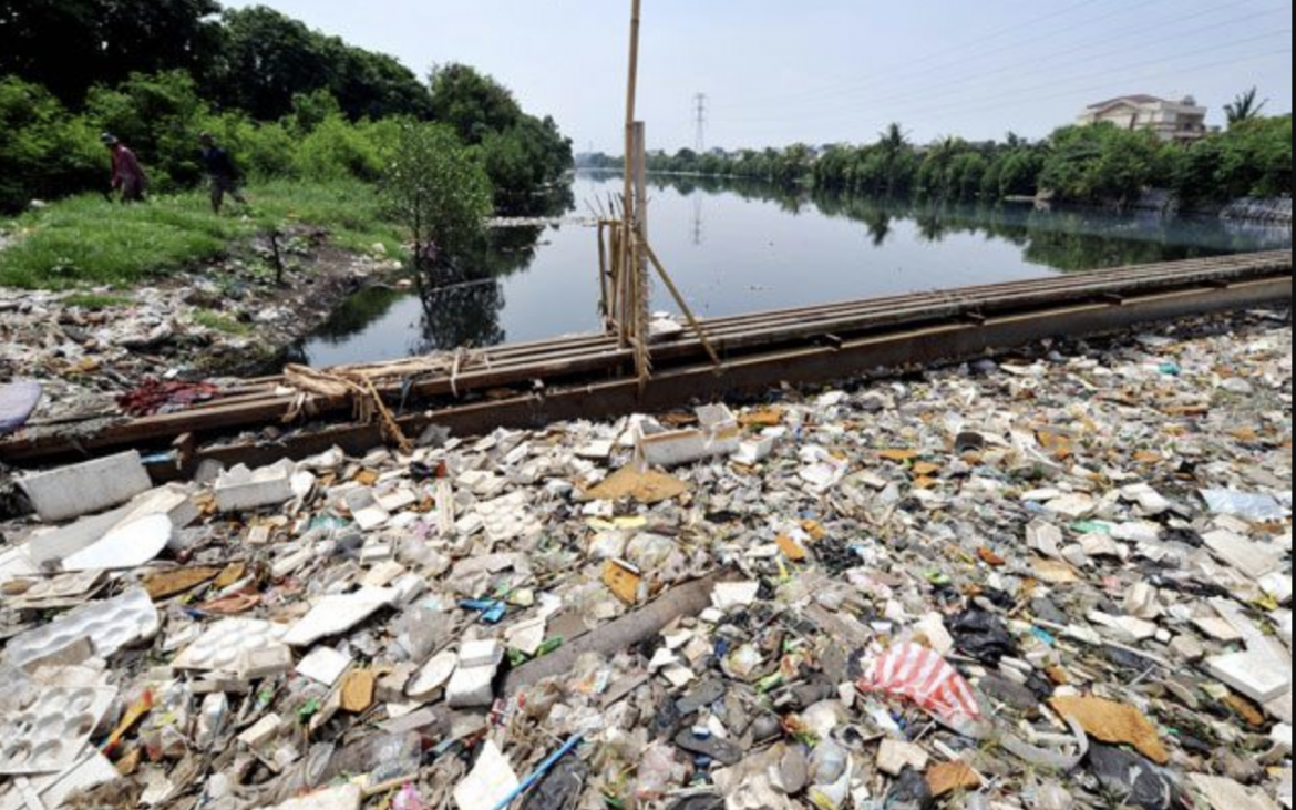 The Citarum River littered with trash dumped from factories