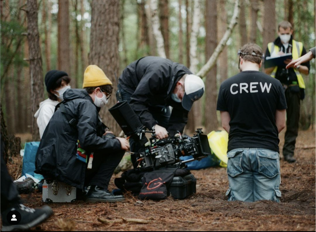 Crew setting up equipment on the set of Once Familiar