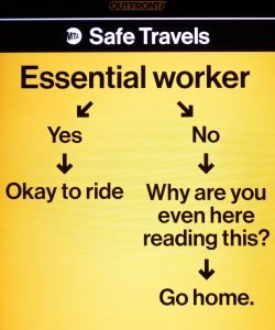 yellow poster, advising people not to go to work unless an essential worker due to coronavirus.