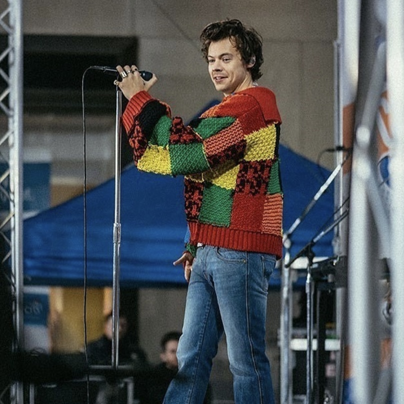 Image of Harry Styles performing.