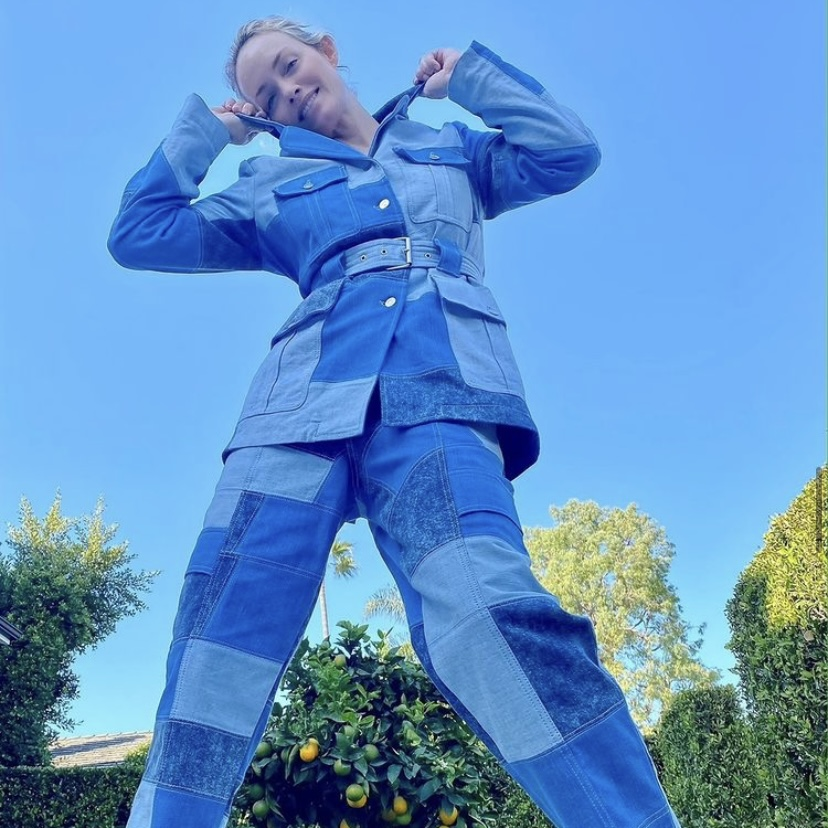 Image of woman in blue denim patchwork co-ord (jacket and trousers)