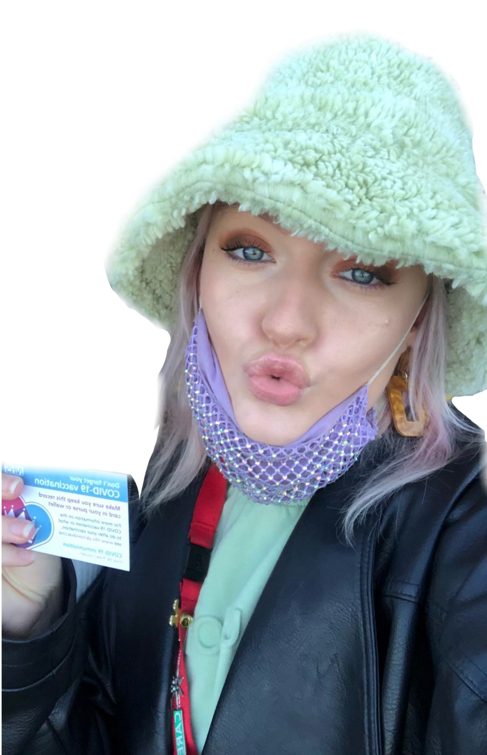 Holding the covid-19 vaccine card after receiving the vaccine