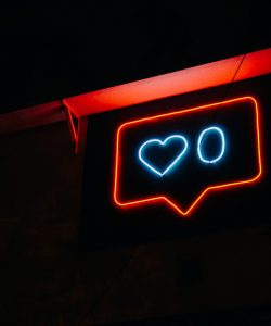 picture of a Instagram like symbol in neon lights