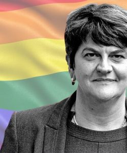Commissioned piece featuring a black and white image of NI First Minister Arlene Foster in-front of the LGBT+ rainbow flag.