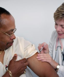Man being vaccinated by nurse