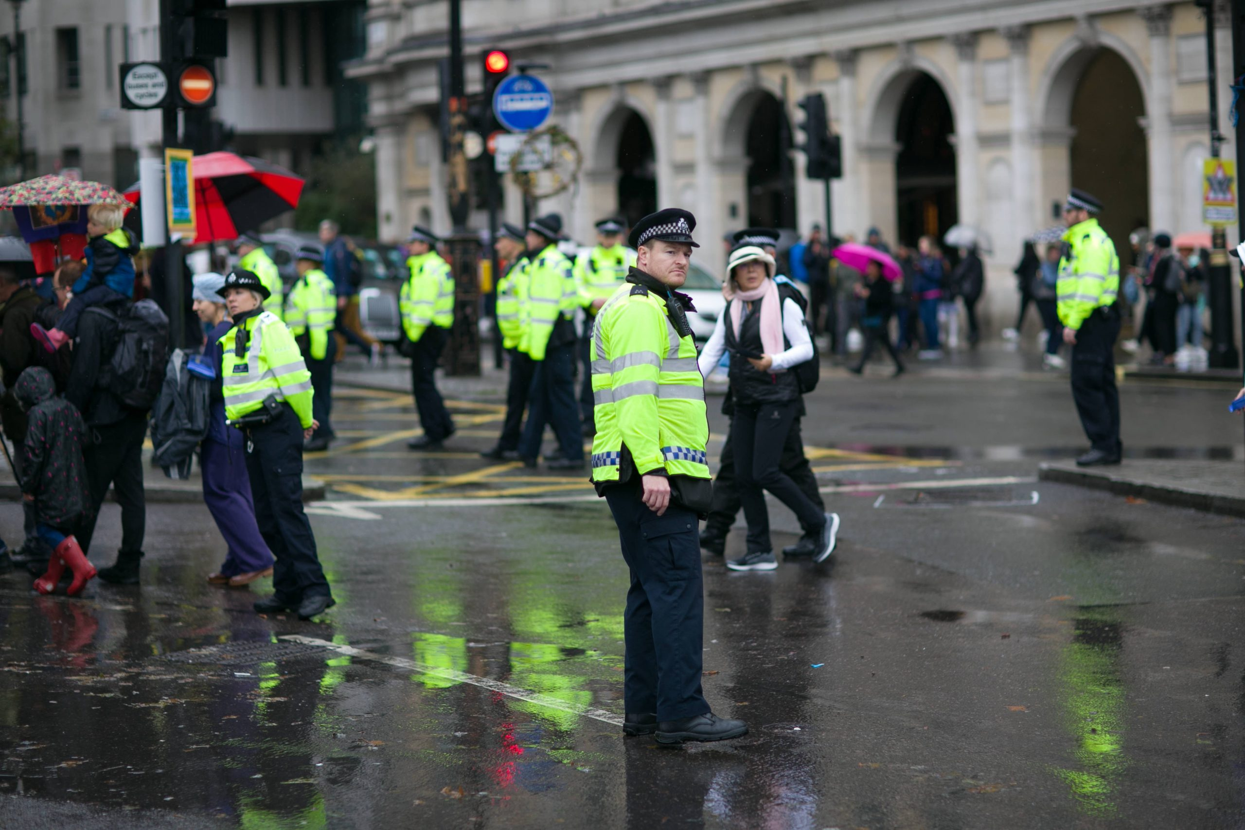 Group of police officers standing one the road and at a crossing