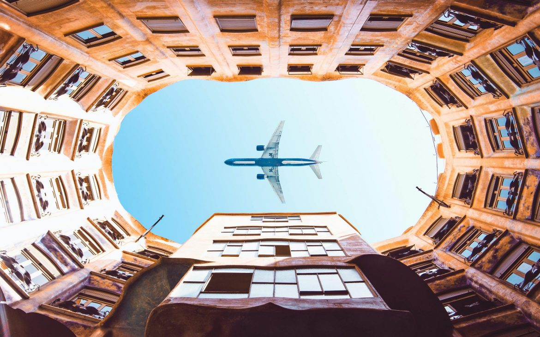 A plane across the La Pedrera building patio. Image by Threeedil on Unsplash.